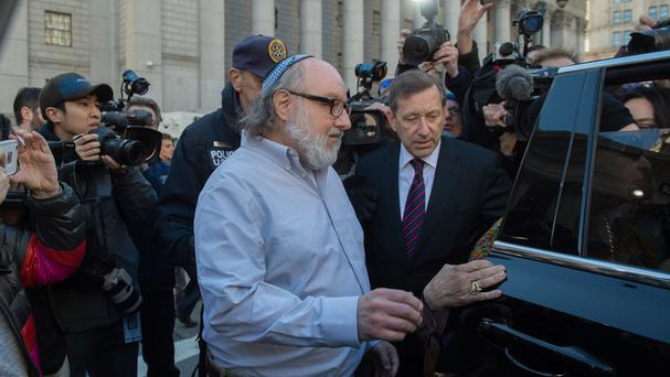 Jonathan Pollard leaves the federal courthouse in New York (AP)