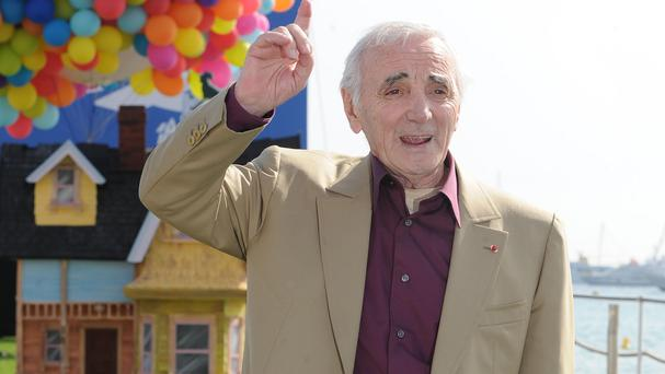 A letter in the Huffington Post is signed by dozens of artists including singer Charles Aznavour