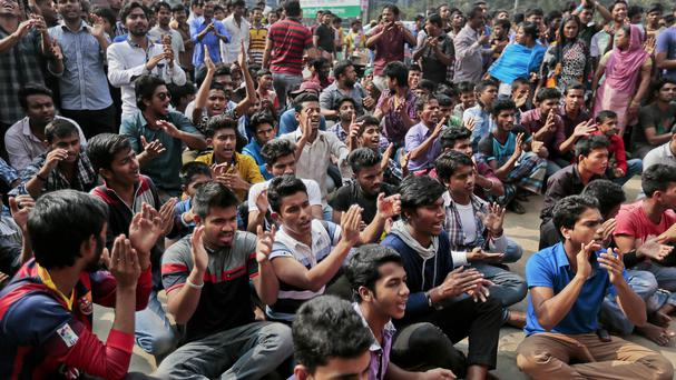 Bangladeshi pro-government activists shout slogans against a nationwide strike called by Jamaat-e-Islami in Dhaka, after death sentences given to two influential opposition leaders were upheld (AP)