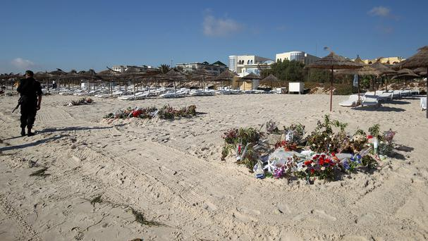 Flowers on the beach at the scene of the massacre in Sousse, Tunisia