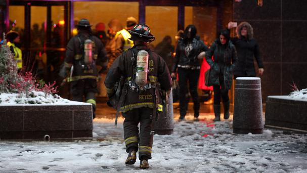 Firefighters conducted floor-by-floor searches during the operation (Chicago Tribune/AP)