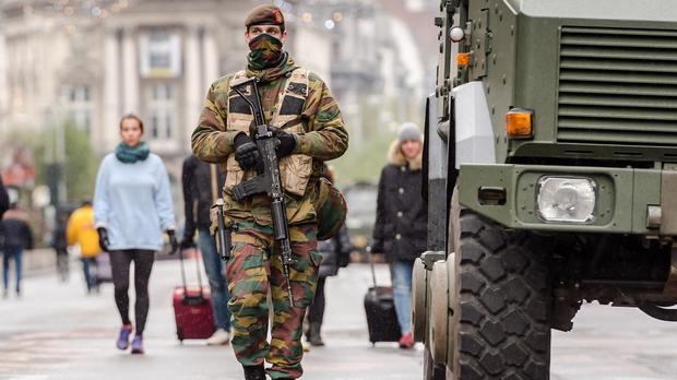 A Belgian army soldier patrols on a main boulevard in Brussels (AP)
