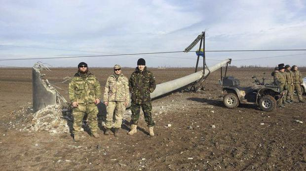 Two transmission towers in Ukraine were damaged by explosions (AP)