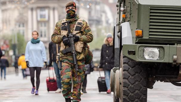 A Belgian army soldier patrols on a main boulevard in Brussels