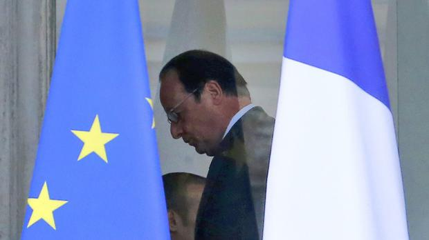 French president Francois Hollande walks through the lobby of the Elysee Palace (AP)