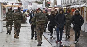 Soldiers patrol the Christmas market along the Champs Elysees avenue in Paris as security is stepped up following the November 13 terror attacks (AP)