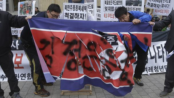 Conservative activists in Seoul during a rally to mark the fifth anniversary of North Korea's artillery attack on the Yeonpyeong island (AP)