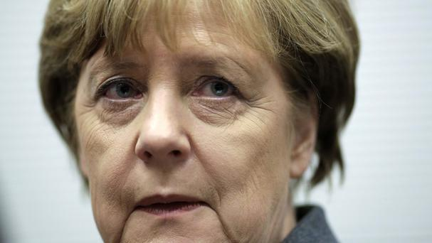 German chancellor Angela Merkel was told by the French president that it would be good if Germany could do more against IS in Syria and Iraq (AP)