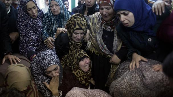 Palestinian women mourn during the funeral of Yahya Taha, who was killed during clashes with Israeli troops on Thursday (AP)