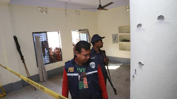 Investigators inspect a mosque that was attacked by unidentified gunmen during evening prayers in northern Bangladesh's Bogra district (AP)