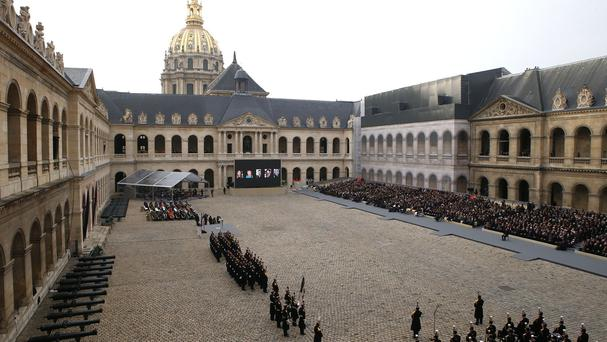 People attend a ceremony in the courtyard of the Invalides in Paris (AP)