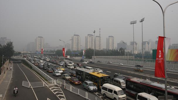 Beijing has been shrouded in grey smog which could alst for several more days