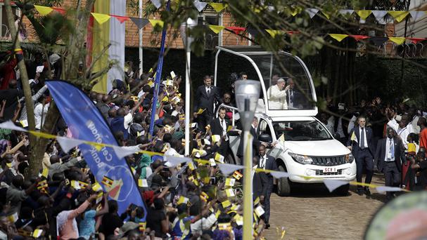 Pope Francis arrives to celebrate mass near the Catholic martyrs' shrine of Namugongo (AP)