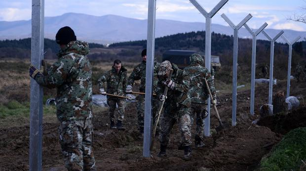 Macedonian soldiers build a border fence to prevent illegal crossings by migrants from Greece (AP)