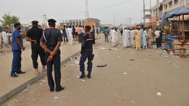 Security officers stand guard at the scene of a suicide bombing in Kano on November 18 - one of a series attributed to Boko Haram (AP)