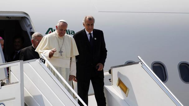 Pope Francis, flanked by aide Alberto Gasbarra, arrives in Bangui, Central African Republic (AP)