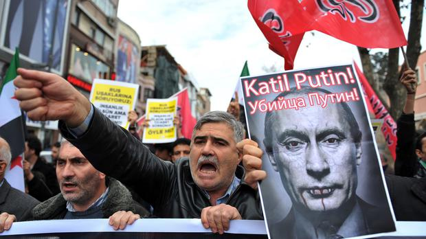Turkish protesters in Istanbul, after Turkey shot down a Russian warplane (AP)