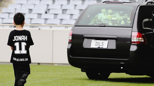 Dhyreille Lomu, son of Jonah Lomu, follows the hearse as it departs the public memorial for the former All Black at Eden Park in Auckland, New Zealand (Hannah Peters/Pool Photo via AP)