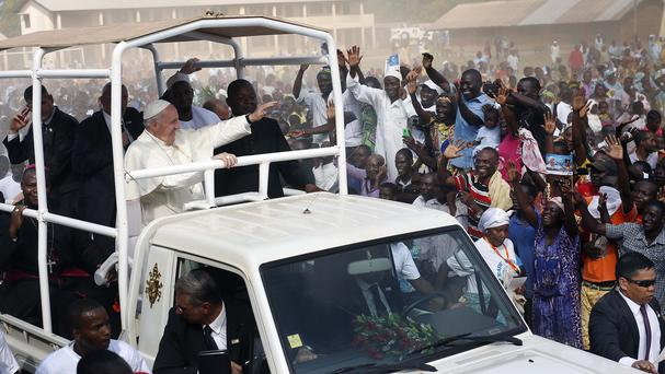 Pope Francis waves to the crowd during his visit to the Central Mosque in Bangui's Muslim enclave of PK5 in the Central African Republic (AP)