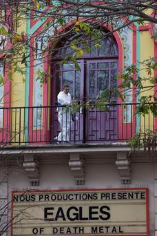 A man is at work during the cleaning process of the Bataclan concert hall, where, on November 13, jihadists armed with AK47s and suicide vests killed 90 people in the bloodiest of a wave of attacks across the French capital, on November 30