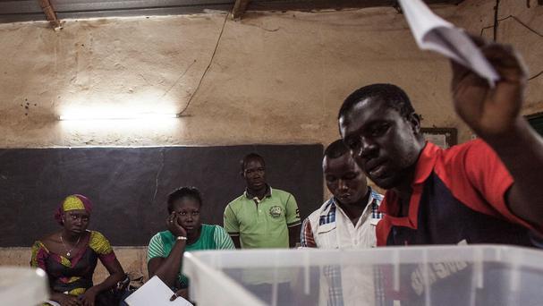 Election officials count ballots in Ouagadougou, Burkina Faso (AP)