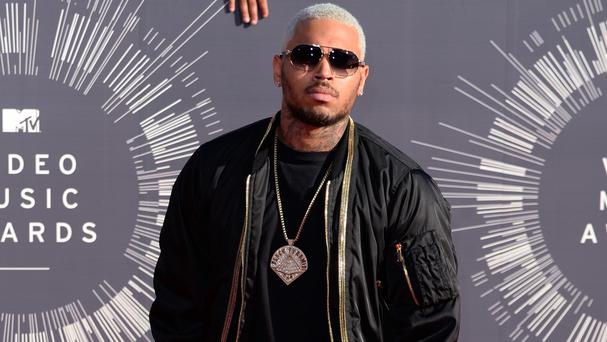 Chris Brown was warned that Australia was considering refusing him a visa