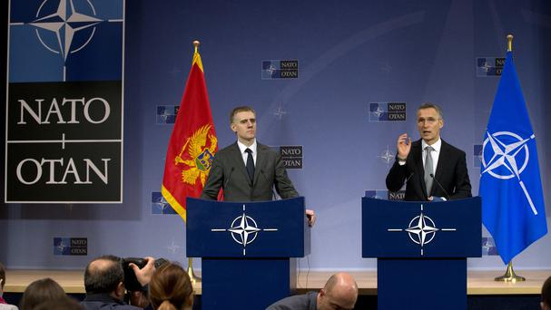 Nato secretary-general Jens Stoltenberg and Montenegro's foreign minister Igor Luksic address a conference at Nato headquarters in Brussels (AP)