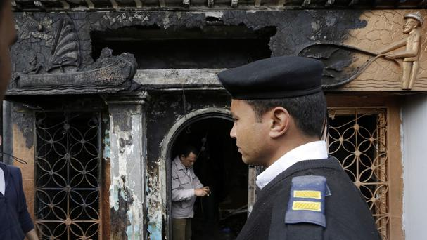 A policeman stands in front a restaurant which was attacked in Cairo (AP)