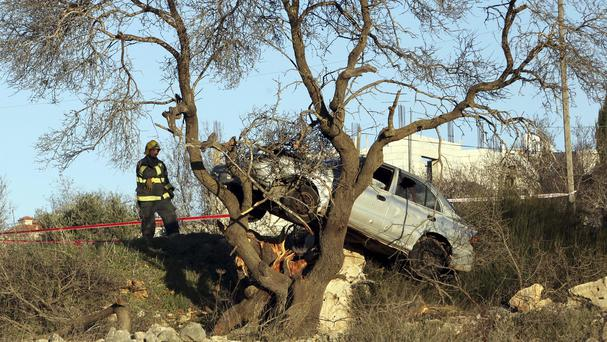 A car used in an alleged attack in the village of Silwad, in the West Bank (AP)