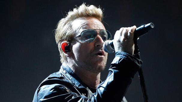 Bono honoured terror attack victims during U2's concert in Paris (AP)