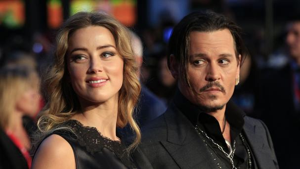 Johnny Depp's wife Amber Heard was charged in July with two counts of illegally importing two pet dogs into Australia