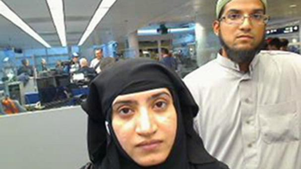 Tashfeen Malik and Syed Farook as they passed through O'Hare International Airport in Chicago in 2014 (US Customs and Border Protection/AP)