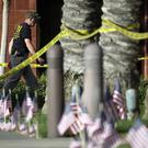 An investigator works the site of a mass shooting in San Bernardino, California (AP)