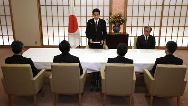 Japanese foreign minister Fumio Kishida addresses the anonymous members of a new counterterrorism unit (AP)