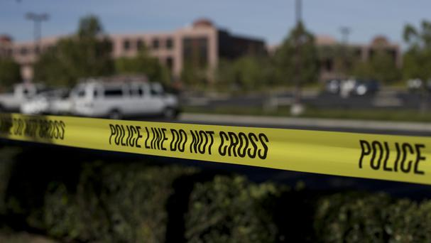 Yellow tape is strung around the Inland Regional Centre, the site of last week's shooting rampage that killed 14 people. (AP)