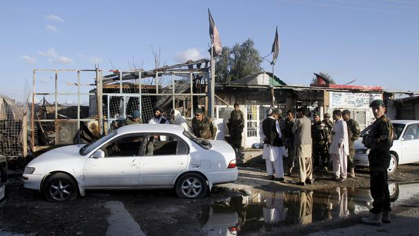 Afghan security forces inspect damages after clashes at Kandahar Airfield (AP)