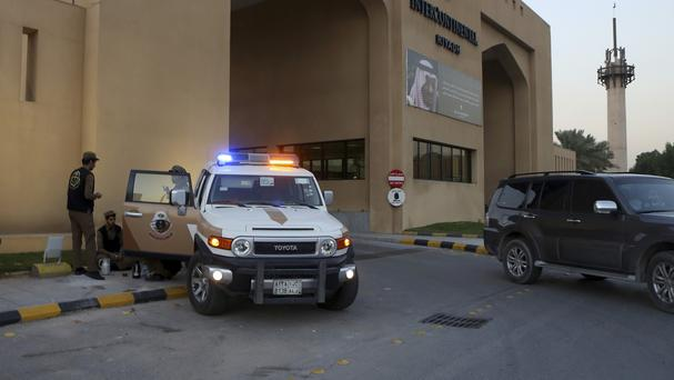 Saudi security forces stand guard outside a hotel where Syrian opposition groups held talks in Riyadh, Saudi Arabia. (AP)