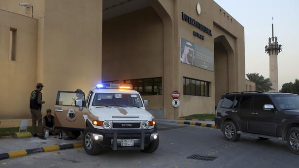 Saudi security forces stand guard outside a hotel where Syrian opposition groups held talks in Riyadh, Saudi Arabia (AP)