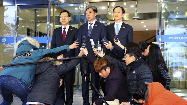South Korea's vice-minister of unification Hwang Boogi, centre, speaks to the media before leaving for Kaesong (Yonhap/AP)