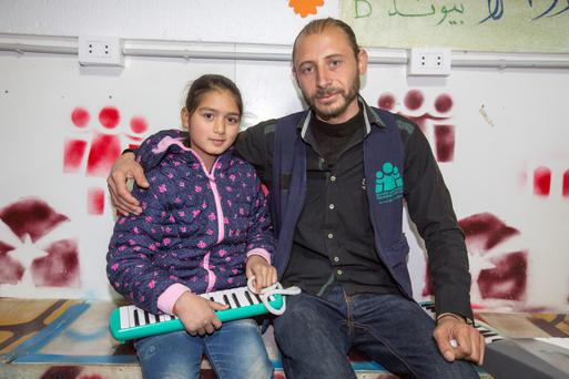 Israa (10) with her music teacher Mouaz (33)