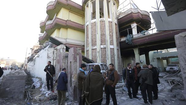 Afghan security forces stand guard at the Spanish embassy after an attack in Kabul (AP)