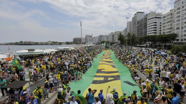 Demonstrators on Copacabana beach in Rio de Janiero call for the impeachment of President Dilma Rousseff (AP)