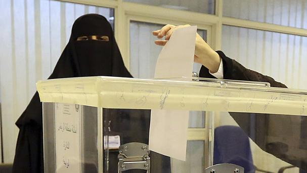 Saudi women vote at a polling centre during the municipal elections in Riyadh, Saudi Arabia (AP)