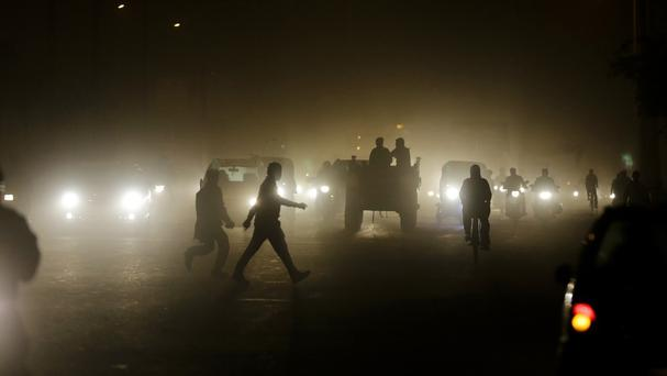 Gloom on a busy road in New Delhi, India (AP)