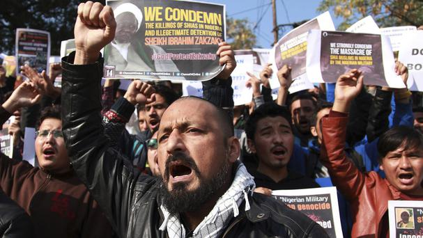 Muslims students shout slogans against the Nigerian government over the killings of hundreds of Shiite Muslims in Nigeria, in Jammu, India (AP)