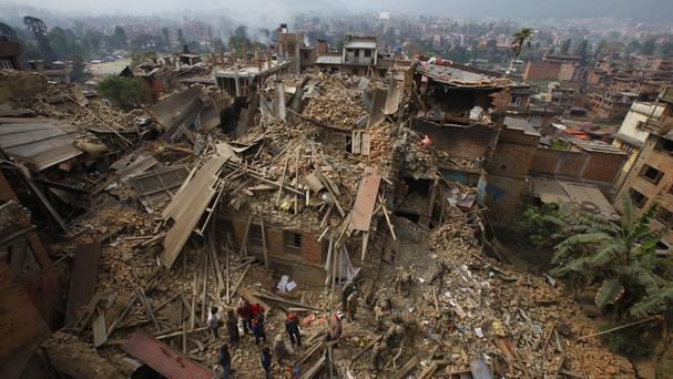 Rescue workers remove debris as they search for victims of the Nepal earthquake (AP)