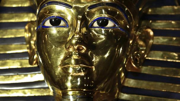 The gold mask of King Tutankhamun is displayed in its glass case in the Egyptian Museum near Tahrir Square in Cairo (AP)