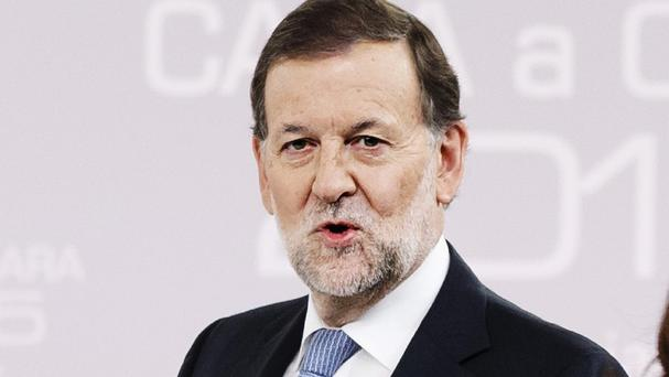 Spain's prime minister Mariano Rajoy did not appear to be seriously injured (AP)
