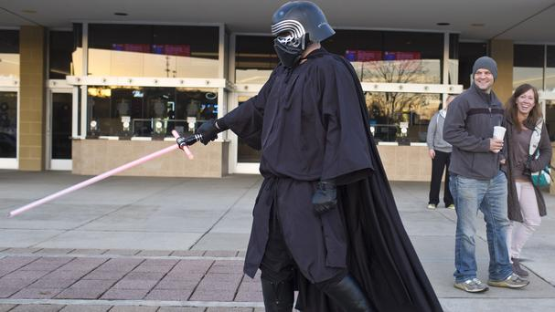 Caleb Creekmore, 22, of Birmingham, Alabama, dressed as Star Wars villain Kylo Ren before the premiere in his home city (AP)