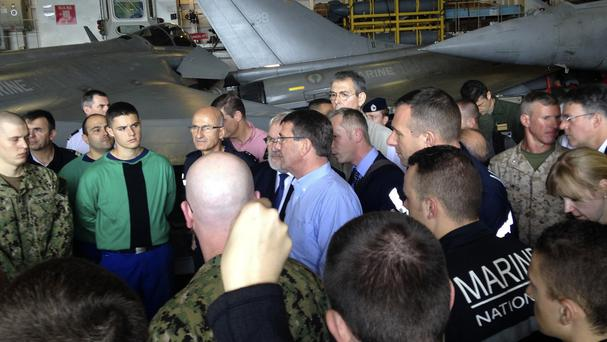 US secretary of defence Ash Carter speaks to US and French troops on the French aircraft carrier Charles de Gaulle in the Persian Gulf (AP)